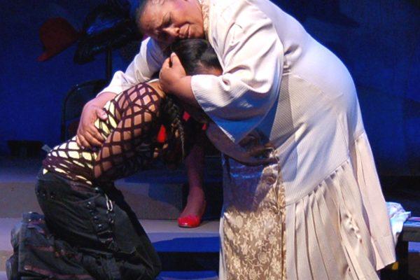 Mother Shaw and Yolanda embrace
